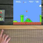 """Geek usa """"instrumento musical"""" para manipular som e imagem de Super Mario"""